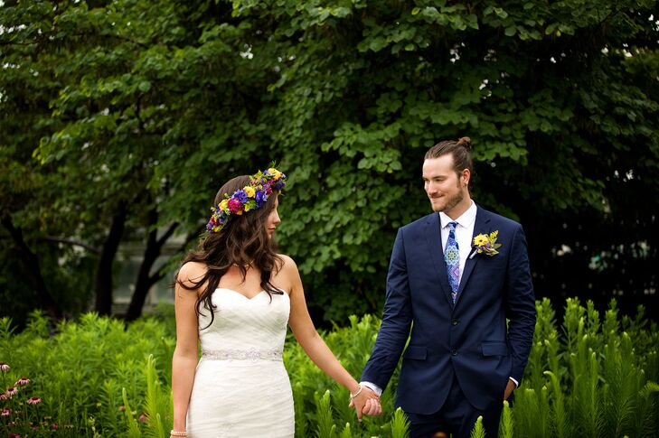 For the boho-chic wedding, Troy wore a navy J. Crew suit with a bold, colorful mandala tie. He completed his look with a yellow and purple boutonniere to match the palette.