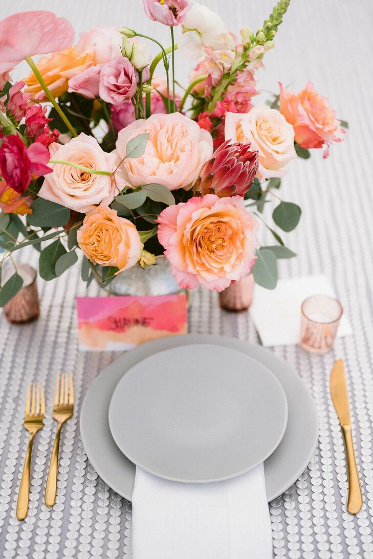 Colorful Tablescape With Gray Plates and Orange Rose Centerpiece