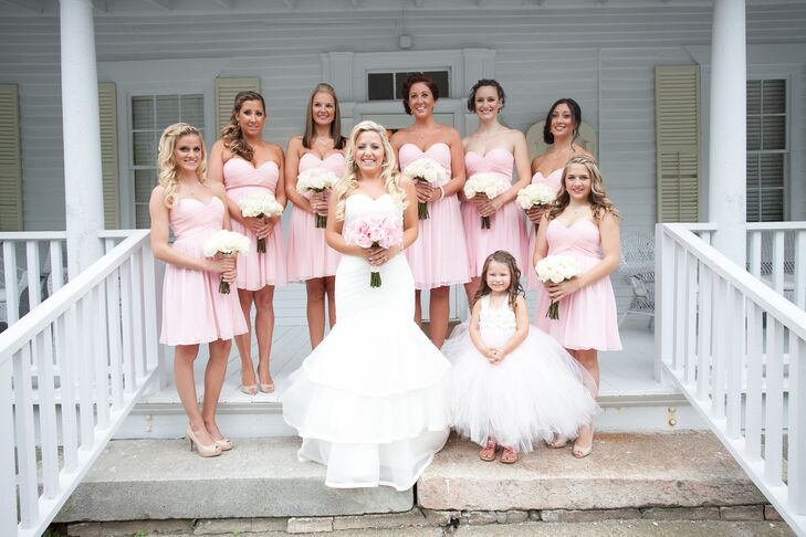 Christine's bridesmaids wore flowy strapless dresses in light pink that fell just above the knee along with nude heels.