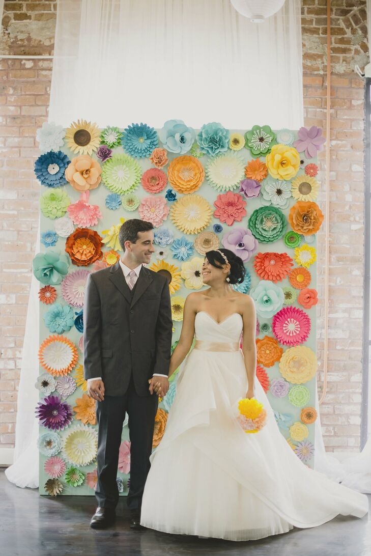Kristy and Mike brightened up their stark, loft-like venue with an abundance of DIY paper flowers and lots of whimsical pastel accents.