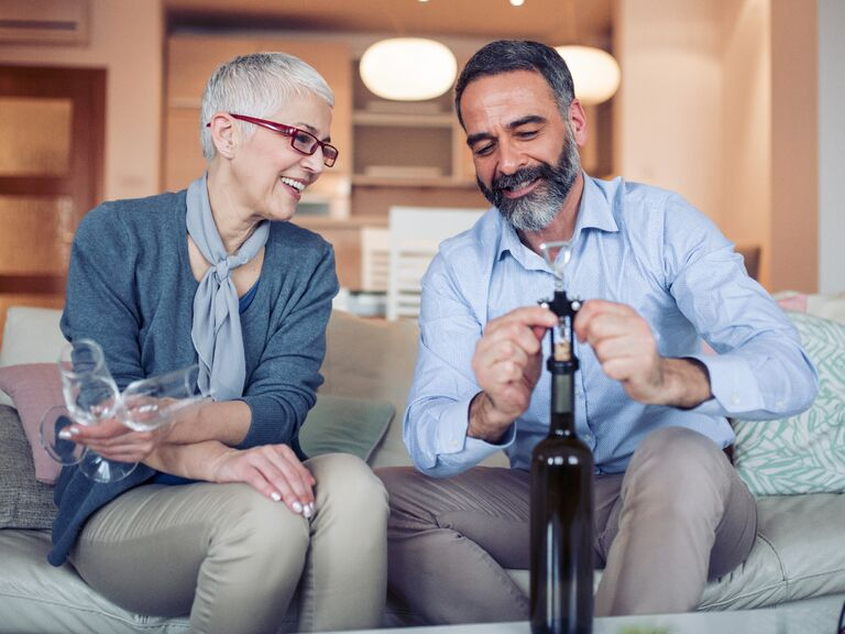 Couple uncorking a bottle of wine to enjoy together