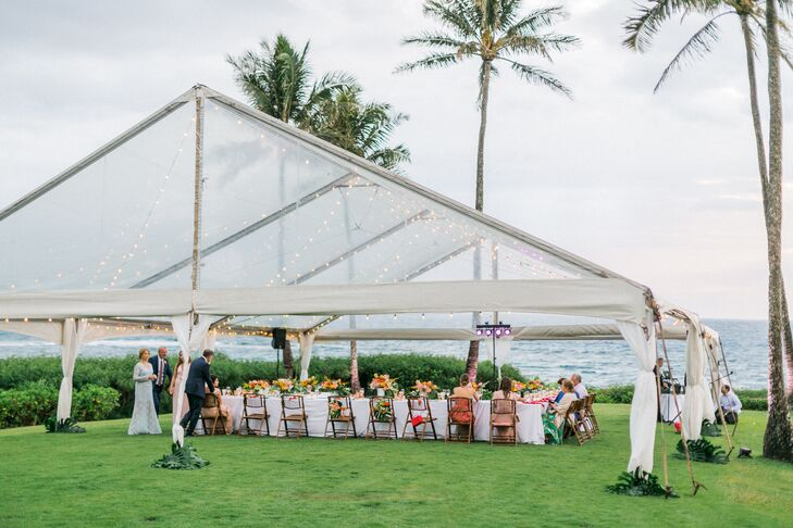 For their intimate reception, the newlyweds treated their guests to an ocean view dinner on the grounds of the Montage Kapalua Bay.