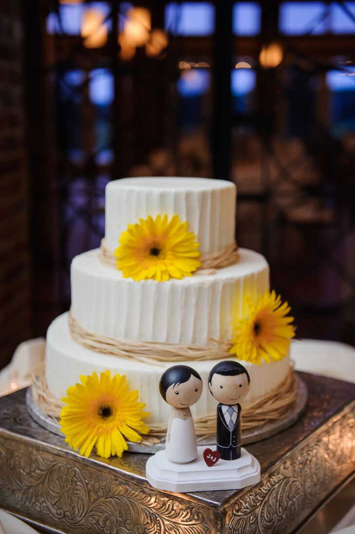 Large yellow gerbera daisies decorated the three tier white cake.