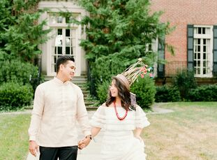 """<br>Ahead of their wedding, the couple took engagement portraits in traditional Filipino attire to honor their heritage. """"JJ's top is called a Barong"""