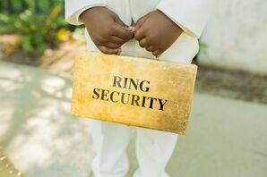 Ring Bearer Holding Gold Ring Security Briefcase for South Carolina Wedding