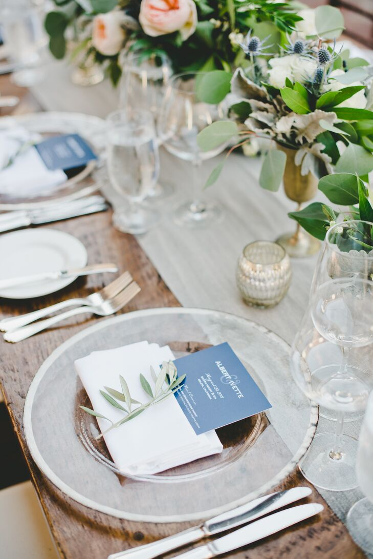 """Ivette and Alberto's vision came to life for the reception with cozy wooden farm tables giving way to metallic accents, cool shades of blue and organic details, achieving a achieved a rustic-chic-meets-modern-elegance aesthetic. """"Our chargers and table settings were the perfect counterpoint to the rustic wooden farm tables,"""" Ivette says."""