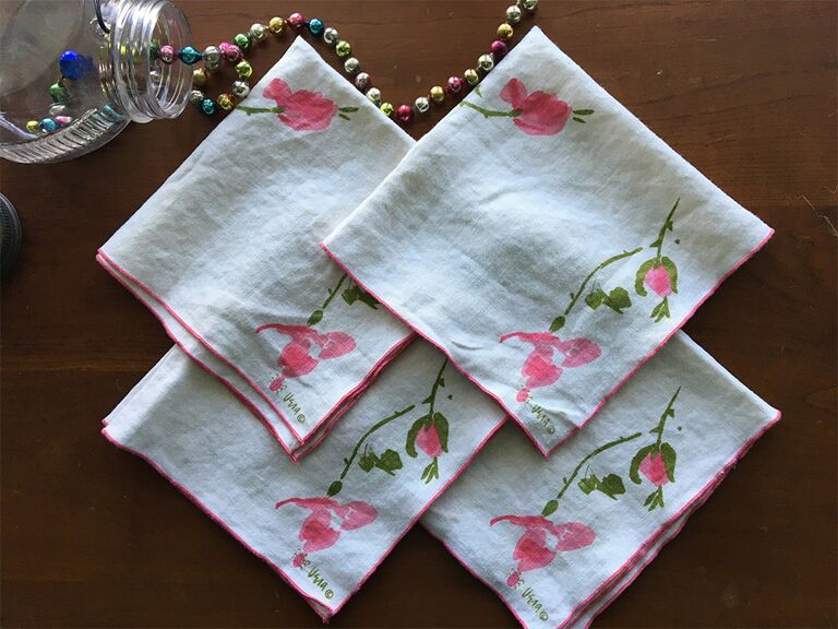 Simple pink floral and pink border on white cloth napkin