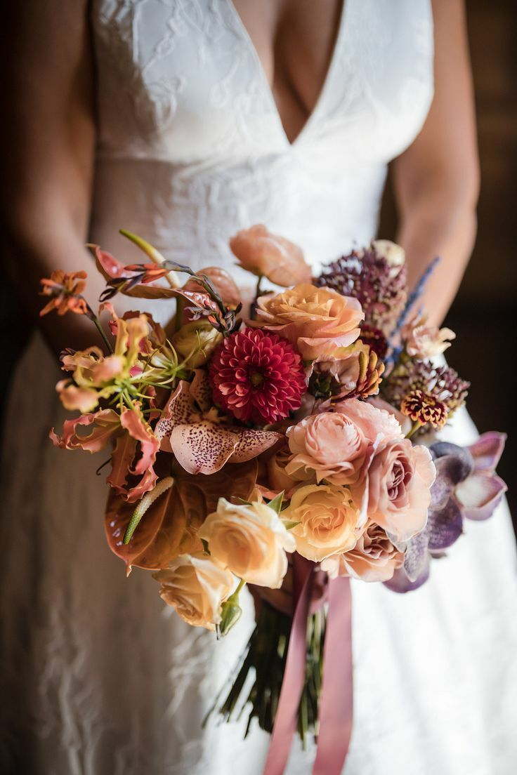 Bride holding bouquet with lilies