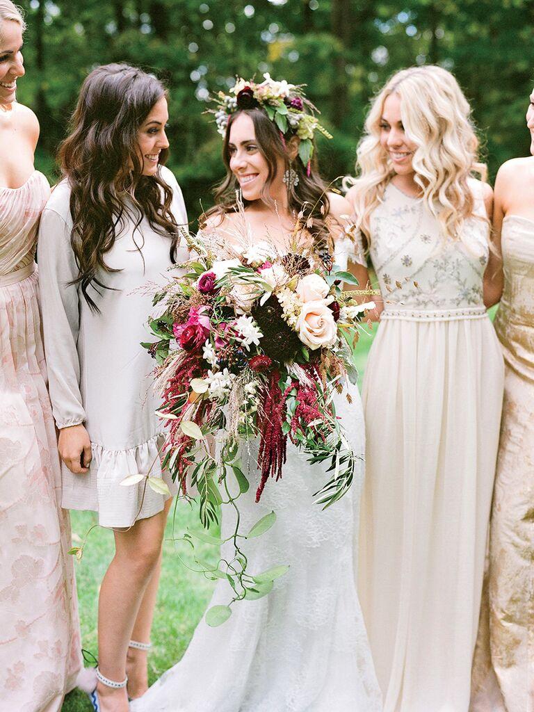 Cascading wedding bouquet idea with dahlias and roses