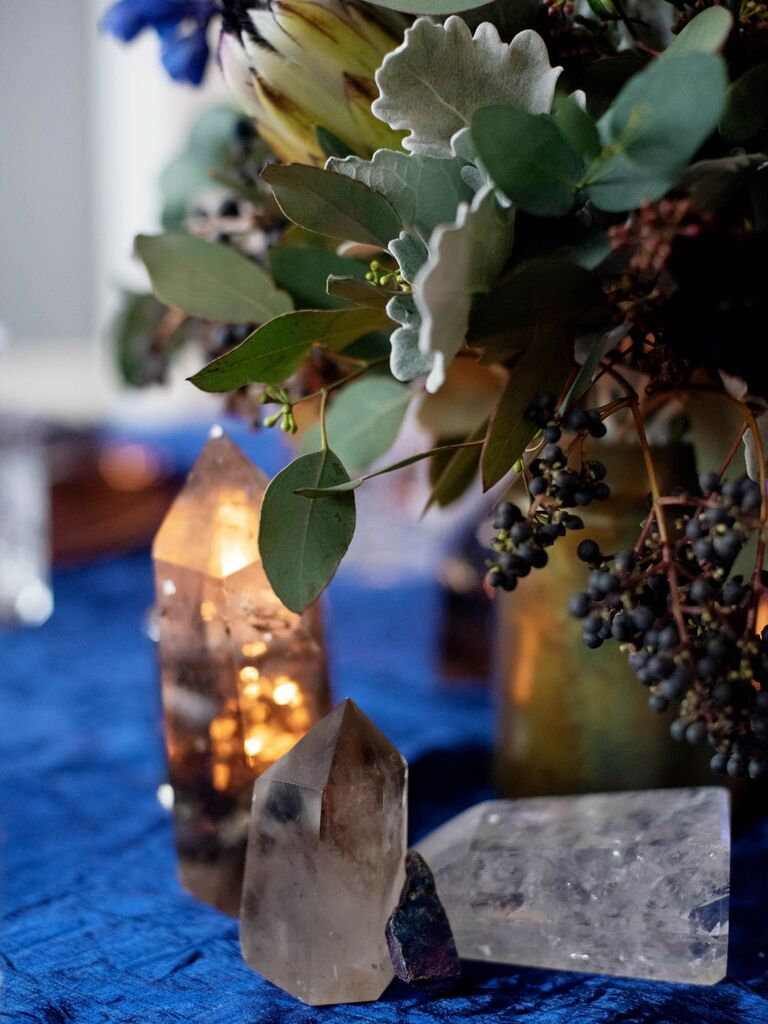 Scattered crystal centerpieces on celestial wedding reception tablescape
