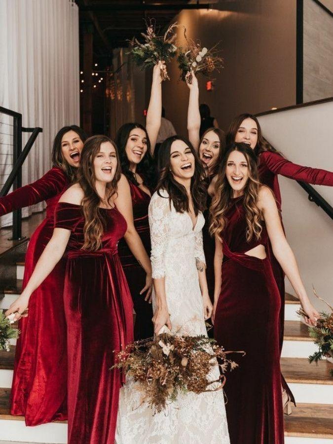 Bridesmaids in red velvet dresses