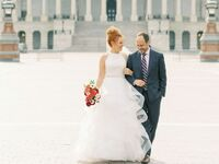 Couple walking in front of United States Capitol