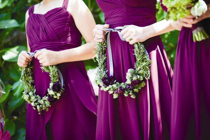 The two junior bridesmaids wore floral crowns of rosemary and plum colored roses.