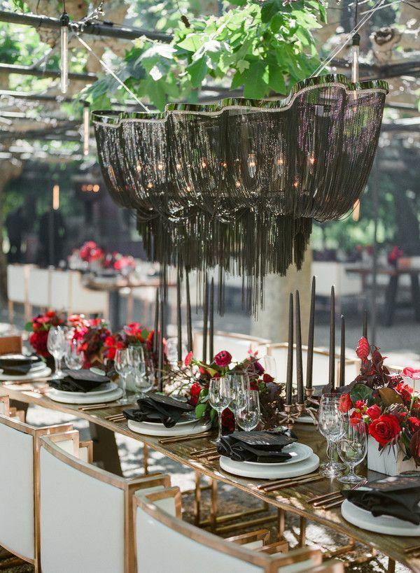 Dramatic black chandelier at wedding reception