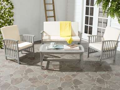 White and gray lounge chairs with gray acacia outdoor table