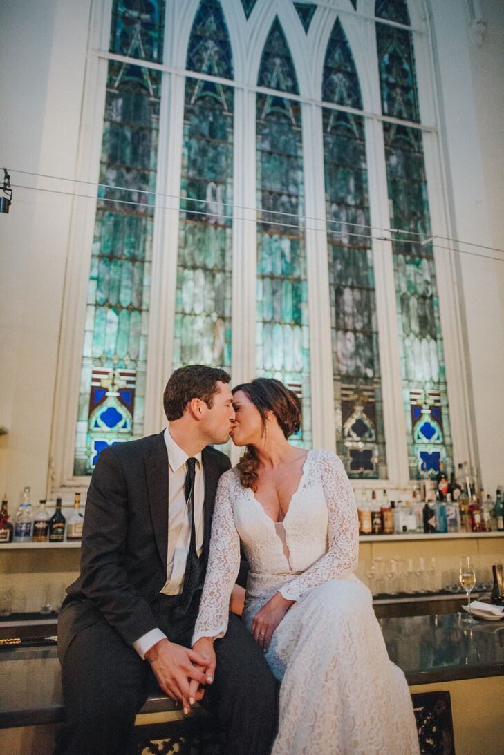 Bride and Groom Share Kiss at Grace Restaurant