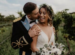 """Maddie and Ernesto describe their vineyard wedding as """"moody boho-chic."""" They took advantage of their Labor Day weekend date to incorporate fall-inspi"""