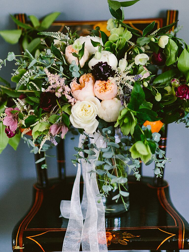 A bridal bouquet with peonies, kumquats and fresh greens