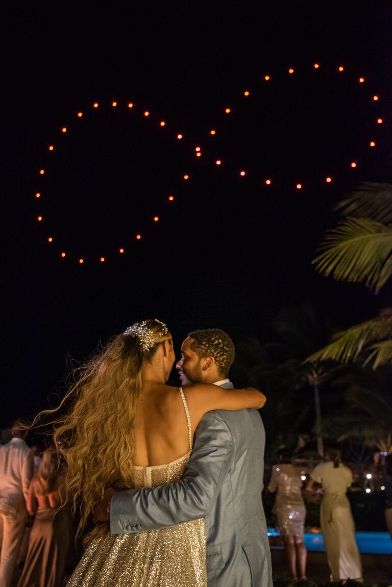 ally love wedding fireworks infinity sign over the couple