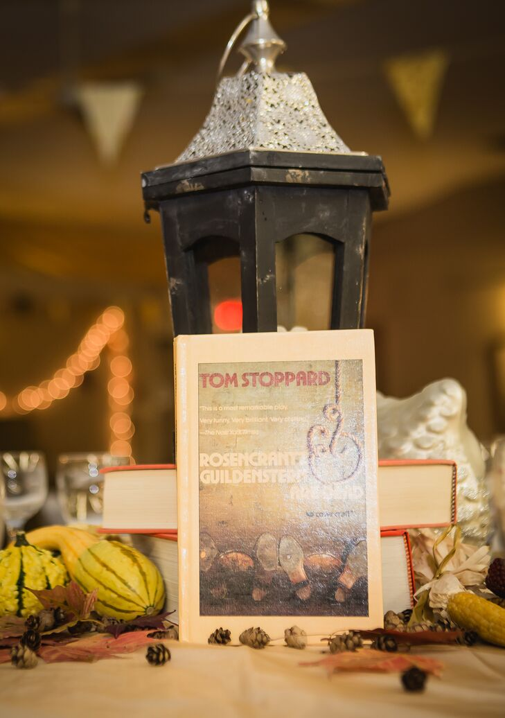 Books were used as centerpiece decor and as table names at the reception.