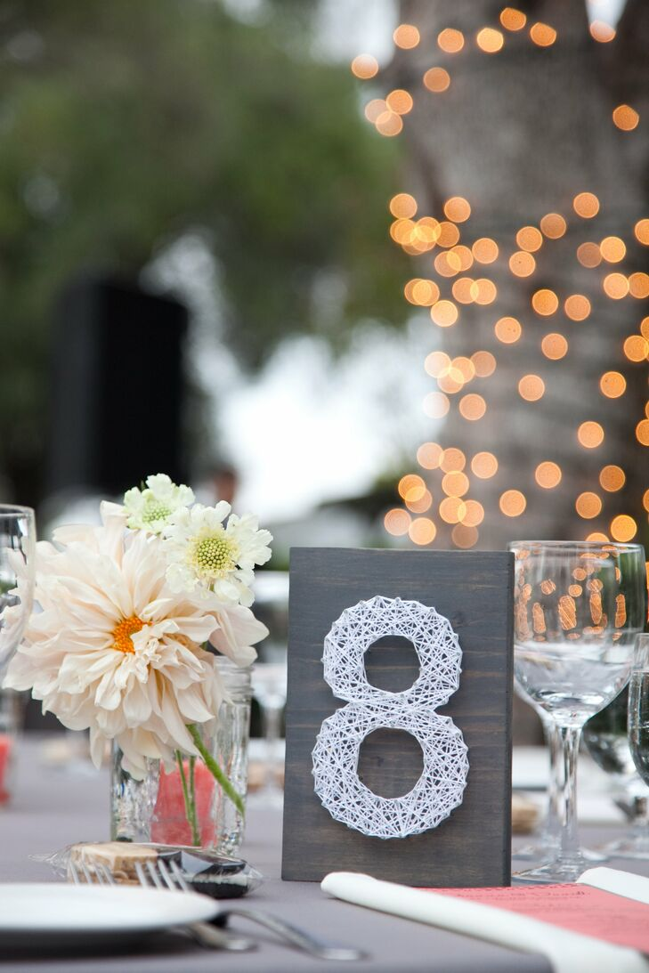 Their planner made the string-art table numbers herself!