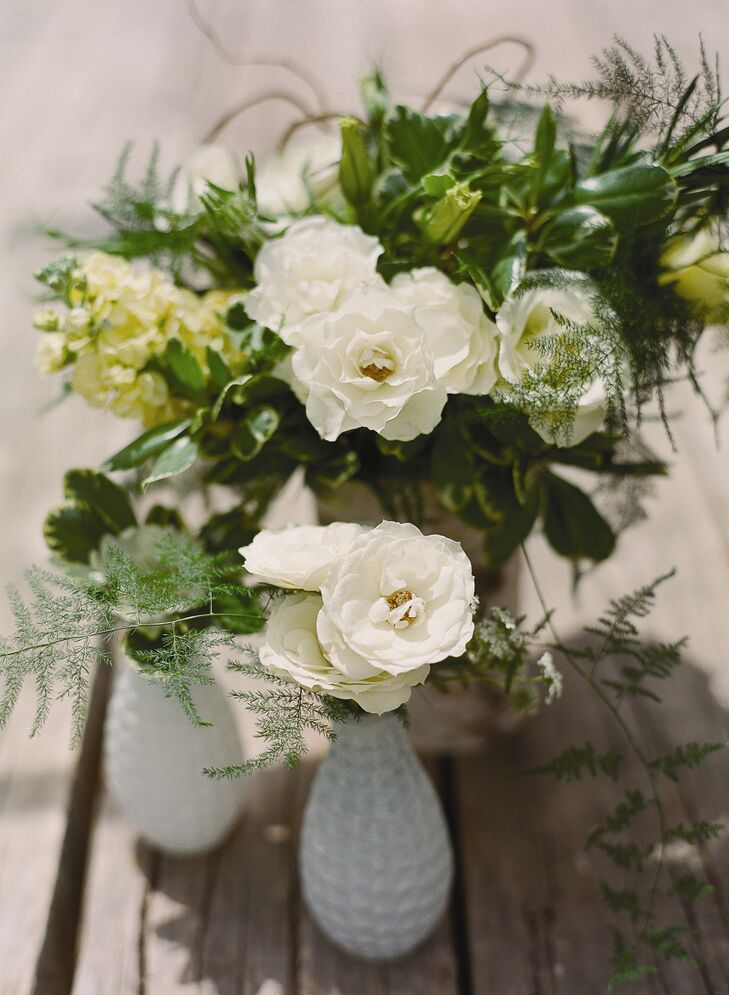 The couple's reception decor was very simple and featured flowers in low, loose settings on each of the tables, inspired by the mountainside location.