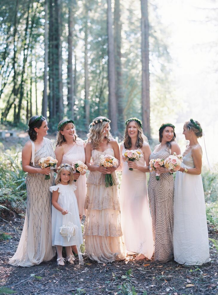 The bridesmaids picked out their own neutral-colored formal dresses based on Liz's gown. The flower girl wore a classic white  dress and carried a basket made by Liz's mother.