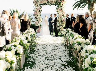 Lush florals and an abundance of blush pink made Michelle Carter and John Gragg's wedding at Bel-Air Bay Club in Los Angeles, California, one to remem