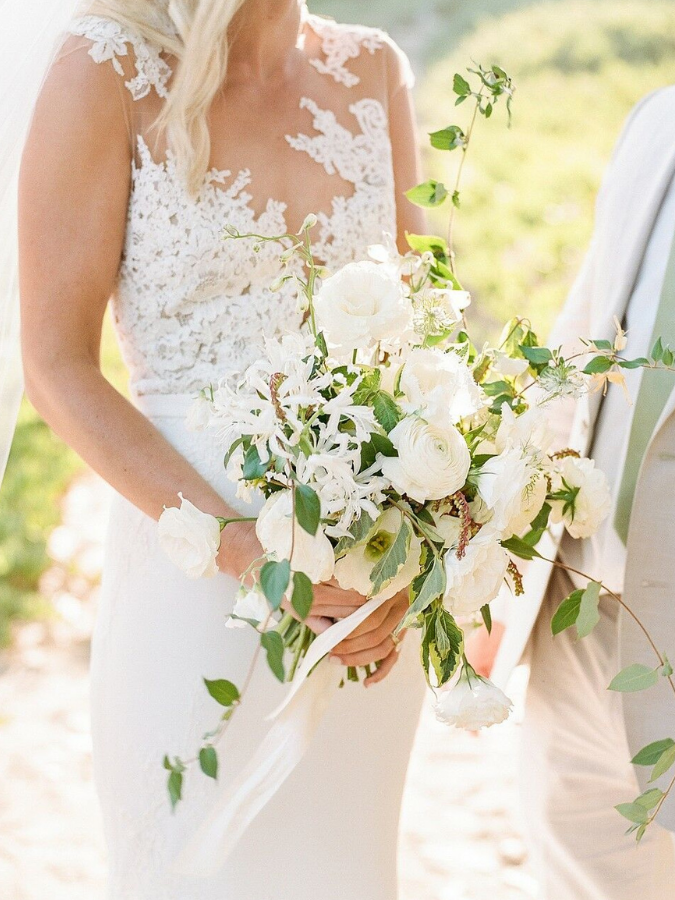 Bride holding organic white-and-green bouquet