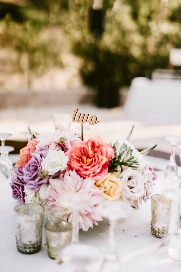 Blossoms in warm tones of coral, pink and yellow added pop to the neutral palette.