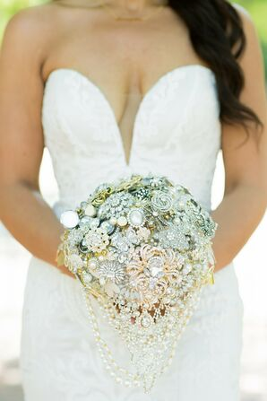 Bride Holding Bouquet of Jeweled Brooches for Wedding at The Lace House in Columbia, South Carolina