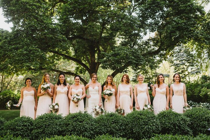 Beth's nine bridesmaids wore peach floor-length Amsale dresses in alternating styles based on each woman's preference.