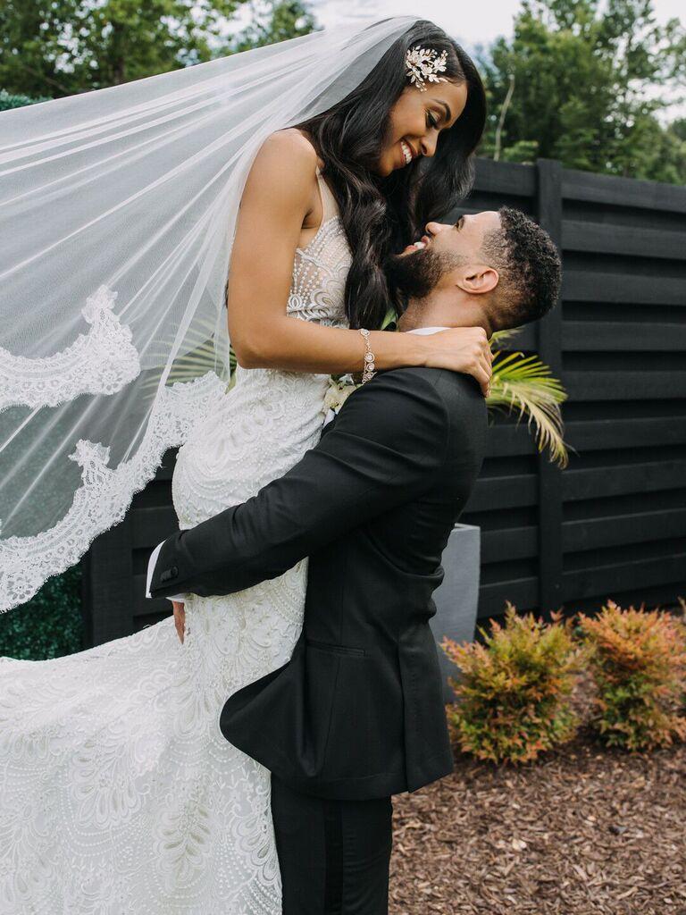 Groom holding bride up