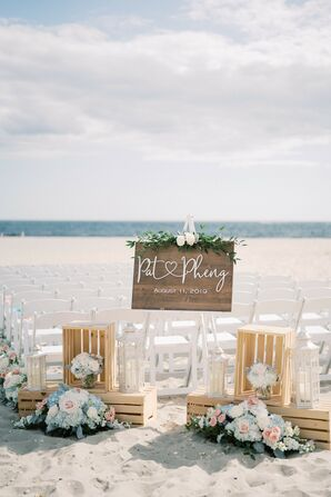 Wooden Welcome Display at Beach Wedding Ceremony