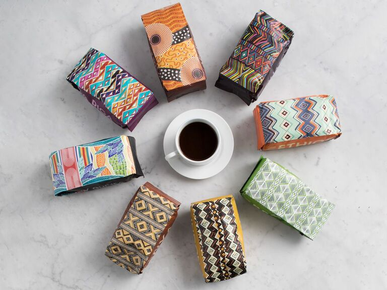 Gourmet coffee packets surrounding cup of coffee