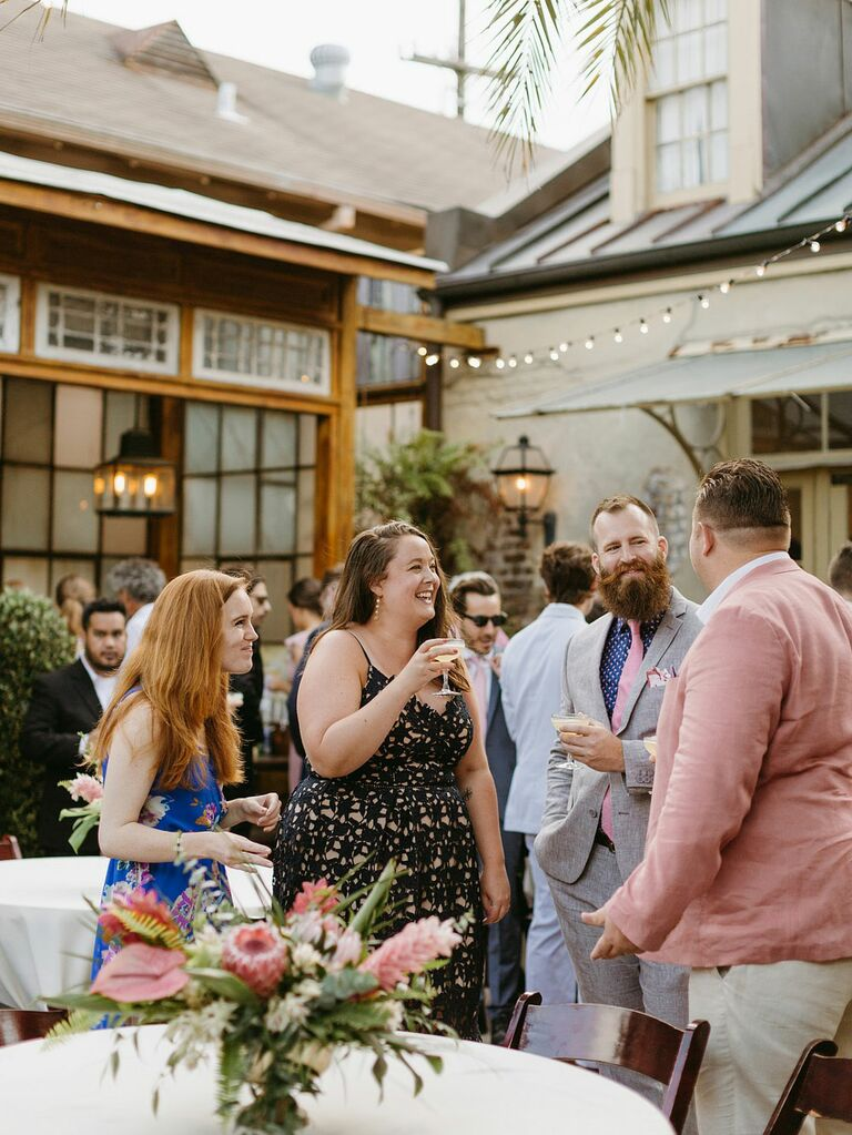 Guests mingling at outdoor formal wedding