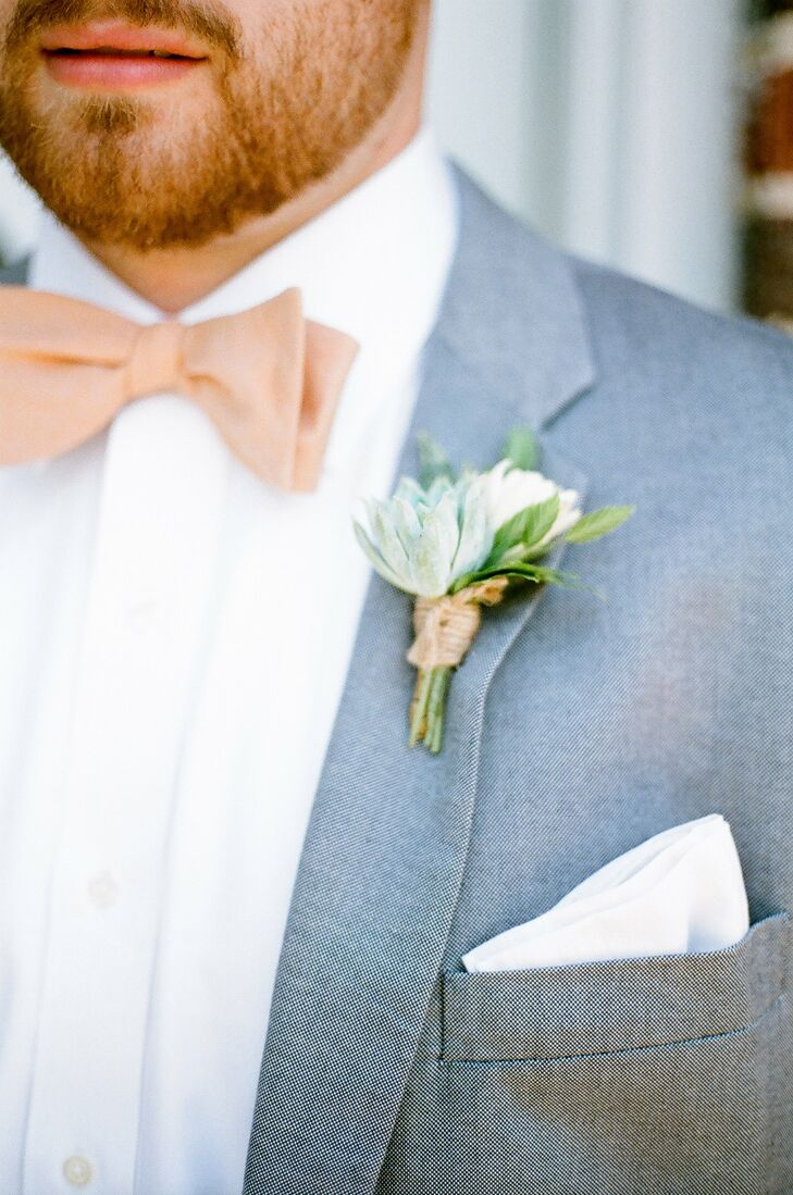 Collin's boutonniere had a rustic feel with fresh green succulents wrapped in twine.