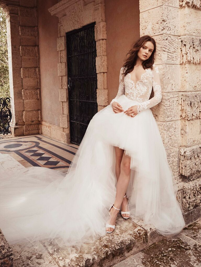 Monique Lhuillier Spring 2020 Bridal Collection high-low wedding dress with tulle skirt and lace long-sleeved bodice