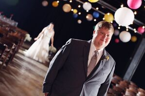Groom in a Gray Suit and Craspedia Boutonniere at First Look