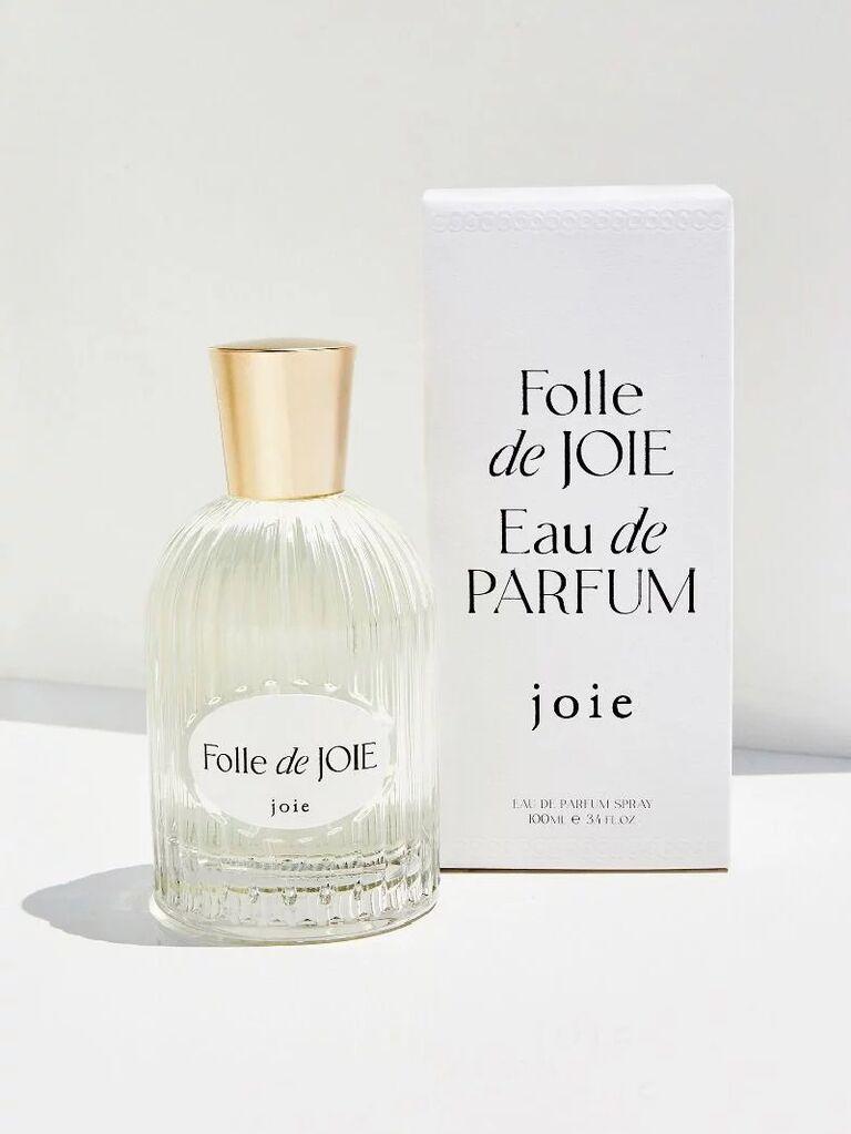 joie Folle de Joie perfume bottle next to packaging
