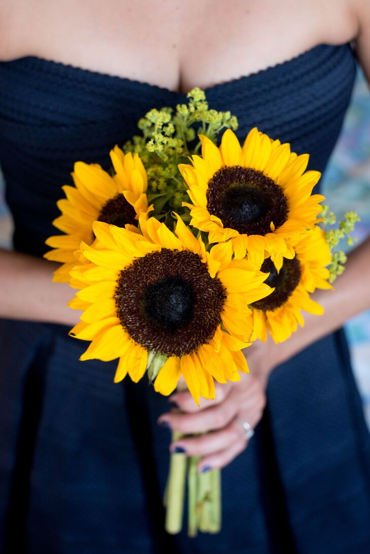 """""""I picked sunflowers for the ladies because they just have a simplistic beauty that makes me happy,"""" says Ashley. """" The men didn't wear boutonnieres because they aren't Dustin's thing and I didn't want anything to look forced."""""""