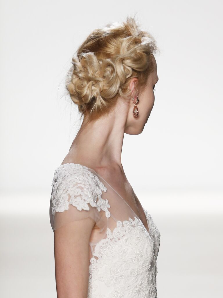 Messy updo hairstyle for a whimsical wedding look