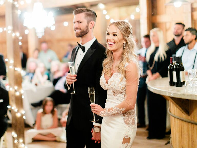 bride and groom with champagne flutes at wedding reception