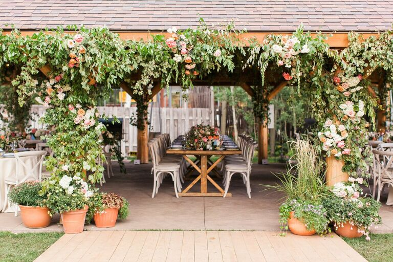Pavilion wedding reception with greenery entryway arch installation