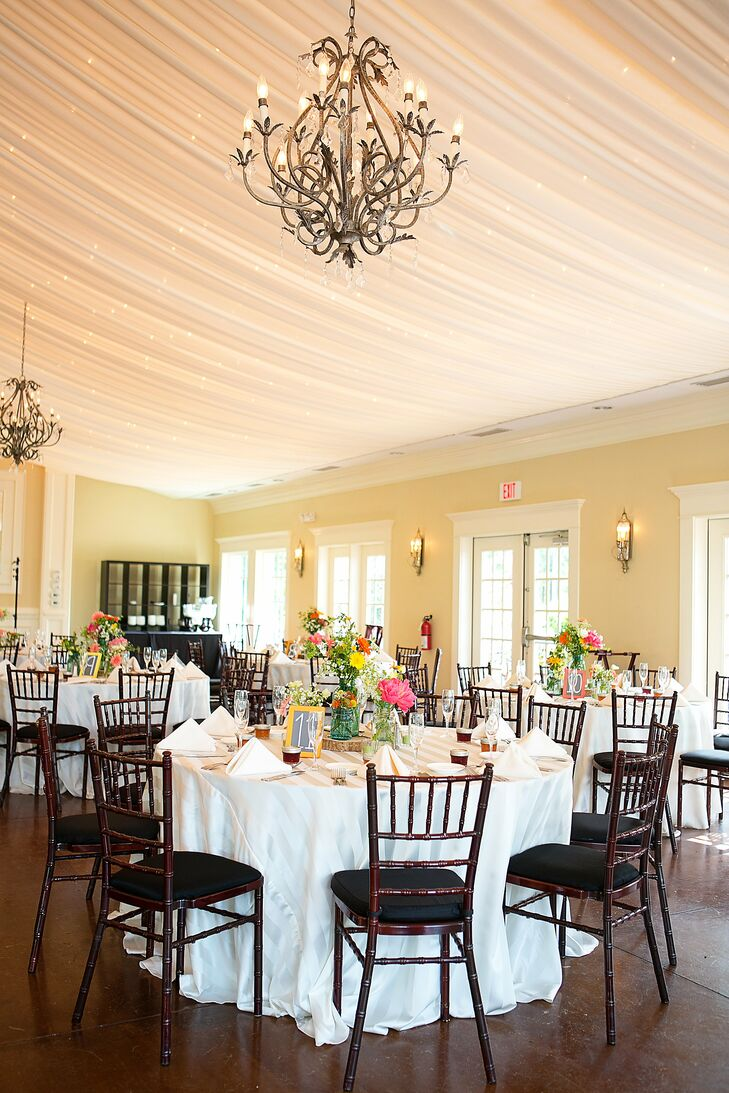 Circular tables were set with crisp ivory linens, and wildflower centerpieces were staggered in height for an eclectic feel.