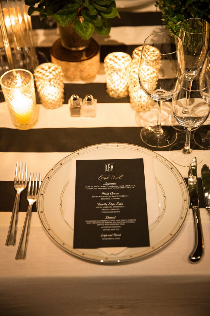 """Modern, striped linens lined the reception tables. """"Each place setting had a black-and white charger and was accented with a crisp white hemstitch napkin and a personalized black and white menu card,"""" Leigh says."""