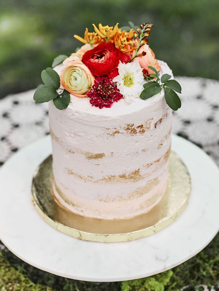 Raspberry-Filled bridal shower cake with fresh flowers