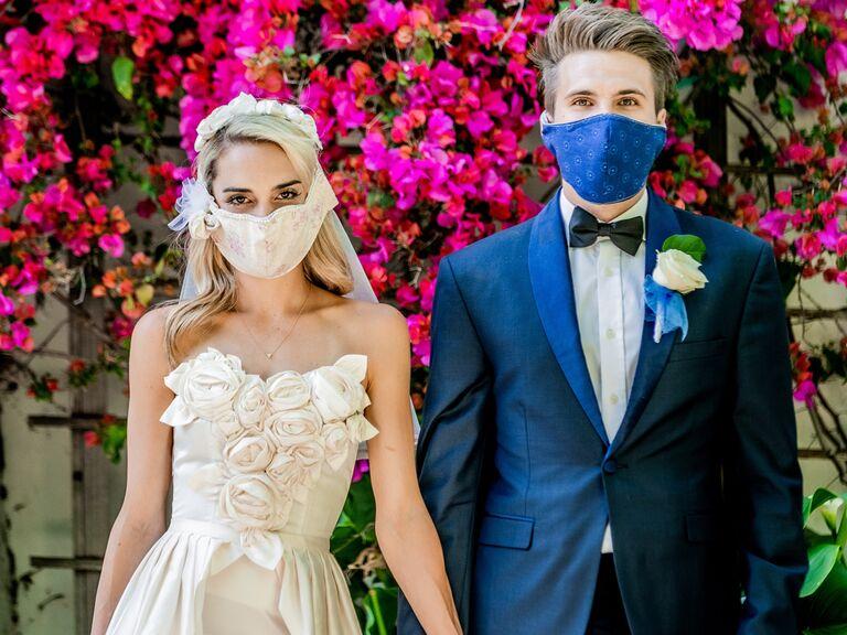 Bride and groom wearing elegant wedding face masks
