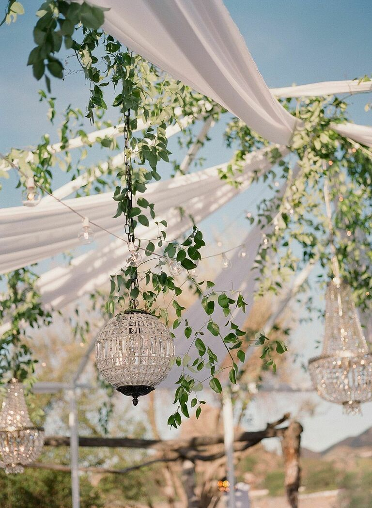 Open-air tent with glass globe chandelier