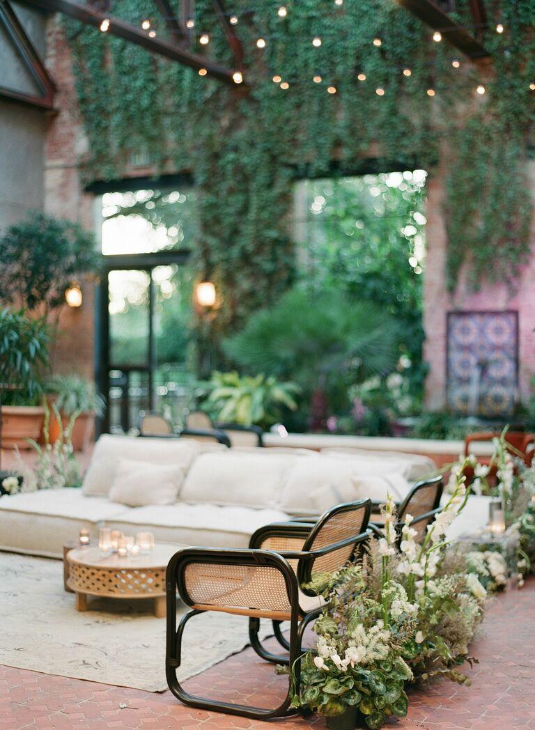 trendy unique indoor wedding reception venue (Hotel Emma courtyard San Antonio) with ivy growing on walls